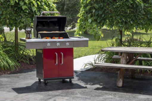 Lifestyle shot of Dyna Glo 3 Burner Red LP Gas Grill - DGG424RNP-D