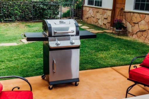 lifestlye shot of the Dyna Glo Premier 2 Burner Propane Gas Grill - DGP321SNP-D