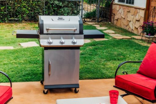 Lifestyle shot of the Dyna-Glo Premier 3 Burner Propane Gas Grill - Stainless DGP397SNP-D