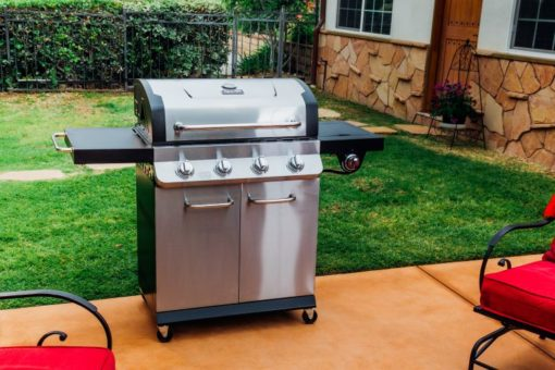 Lifestyle shot of the Dyna Glo Premier 4 Burner Propane Gas Grill - DGP483SSP-D