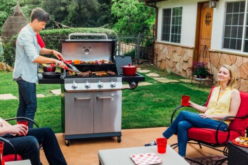 Lifestyle shot on the Dyna Glo Premier 4 Burner Propane Gas Grill - DGP483SSP-D