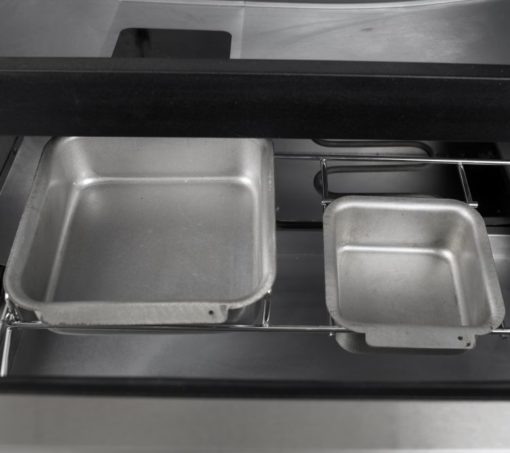 Wood chip tray on the Dyna Glo Two Door Digital Bluetooth Electric Smoker DGU951SDE-D 40