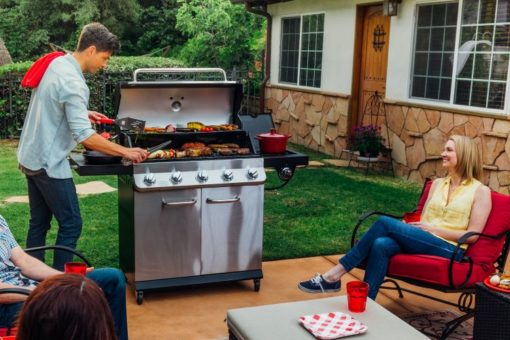 Lifestyle shot of the Dyna Glo Premier 5 Burner Propane Gas Grill - DGP552SSP-D