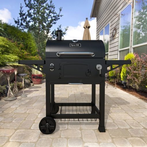 Lifestyle shot of the Dyna-Glo Heavy-Duty Charcoal Grill Black Powder Coat - DGN486DNC-D