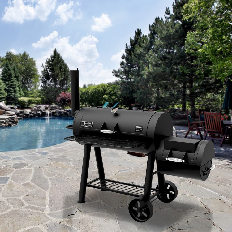 lifestyle shot of the Dyna-Glo Signature Series Barrel Charcoal Grill and Offset Smoker - DGSS962CBO-D